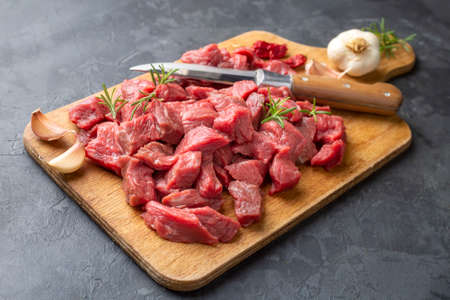 Heap of raw chopped beef isolated on cutting board
