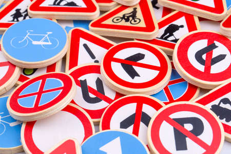 Different colored traffic signs on the white background