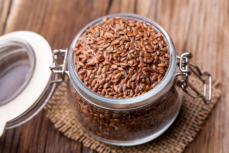 Flax seeds on a wooden background