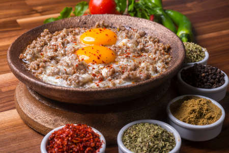 Fried egg with mince meat in traditional turkish pan, close view (Kiymali Yumurta)