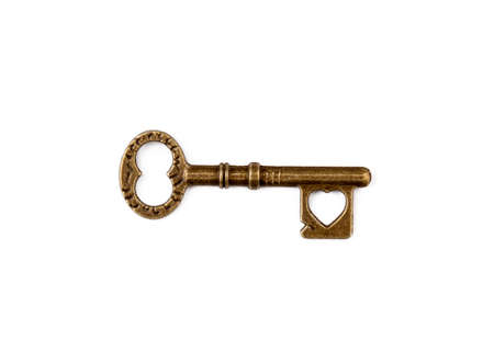 Old antique key on white background
