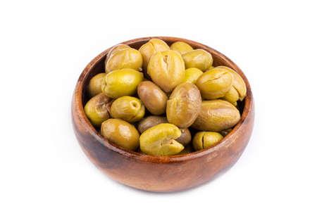 Cracked green olives on the white background. Turkish style olive (Turkish name; kirma olive) 免版税图像