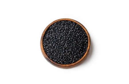 Black beluga lentils on the white background 免版税图像