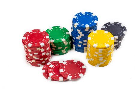 Poker chips on the white background 免版税图像