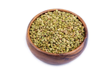 Organic Heap of dried thyme seeds on a background.