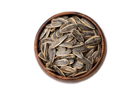Salted sunflower seeds on a white background