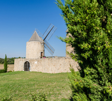 airstream: Windmills in the village of Regusse in Provence, France Stock Photo