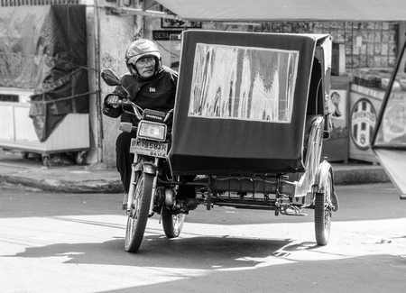 motociclista: An Indonesian motorcyclist in Binjai Town in Northern Sumatra Editorial