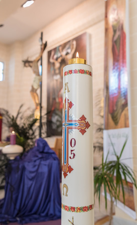 christian candle: Decorated candle in a Christian Church Stock Photo