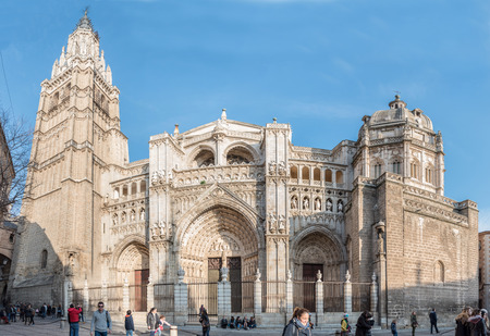 Tourists in Plaza del Ayuntamiento in front of the Cathedral of Saint Mary of Toledo, Spain.