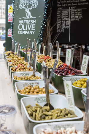 uk cuisine: Various assortment of olives sold at Borough Market in London, UK Editorial