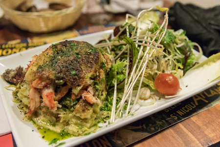 Delicious crab lasagne with salad in a restaurant in Punta Arenas, Chile Stock Photo