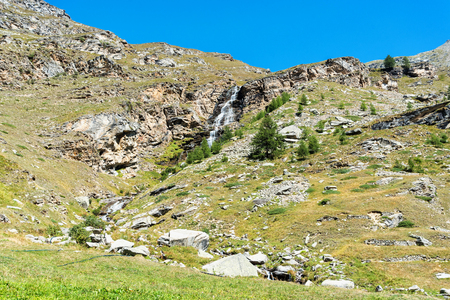 Waterfall near Ceresole reale in the Gran Paradiso National Park in Italy