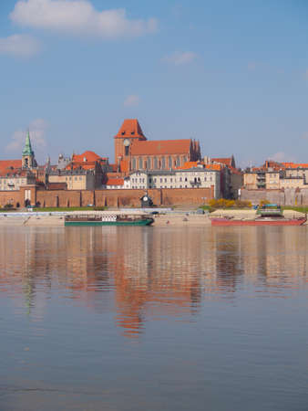 Panoramic view of old town of Torun, Poland - UNESCO heritage site - across Wisla river Stock Photo