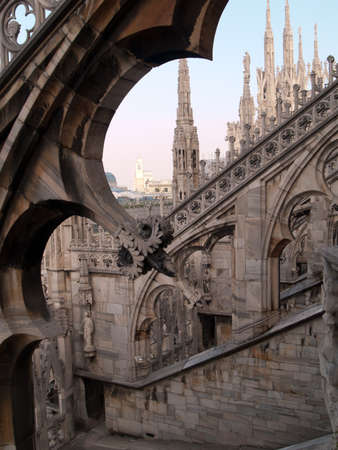 stone arches: carved stone arches on roof of gothic cathedral in milan