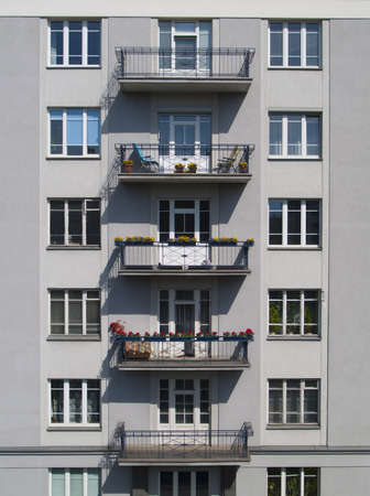 windows on the wall of apartment building Stock Photo
