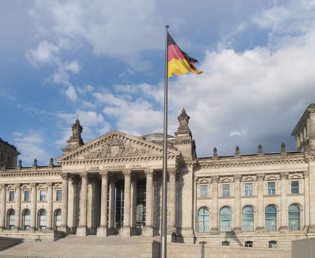 German parlament building (Reichstag) with national banner in sunny day photo