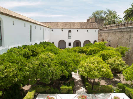Inner garden and castle wall in Alcazar de los Reyes Cristianos, Cordoba, Spain