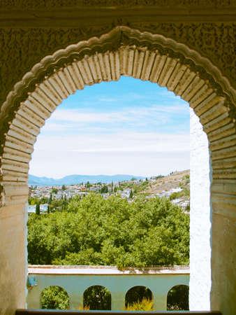 View of Granada, Spain from moorish window of Alhambra palace photo