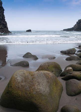 damp stones on the sand ocean beach