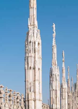 gothic spires over blue sky on roof of Milan cathedral  Duomo , Italy Stock Photo - 15179516