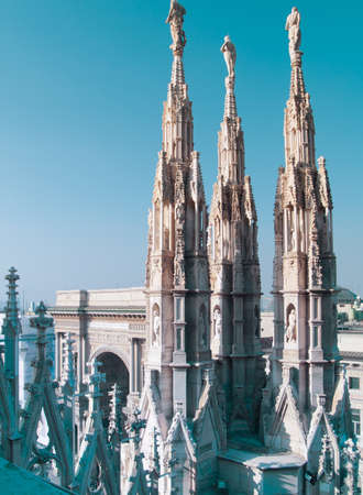 gothic spires over blue sky on roof of Milan cathedral  Duomo , Italy Stock Photo - 15179546