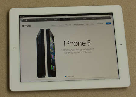 iphone5: WARSAW, POLAND - SEPTEMBER 13, 2012: Photo of a Apple iPad device, showing the apple.com homepage premiere of new iphone5 on september 13, 2012 in Warsaw, Poland.