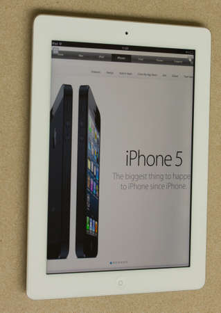 WARSAW, POLAND - SEPTEMBER 13, 2012: Photo of a Apple iPad device, showing the apple.com homepage premiere of new iphone5 on september 13, 2012 in Warsaw, Poland.