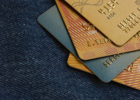 golden credit cards details on jeans background photo