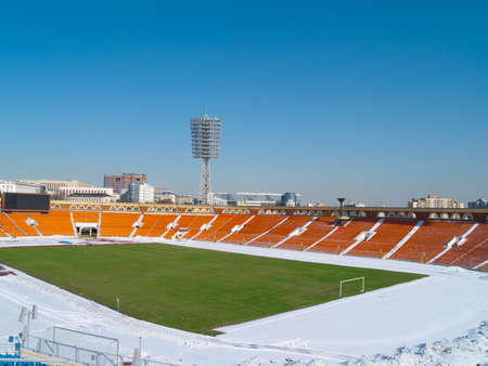 snow ground: Empty city stadium under snow
