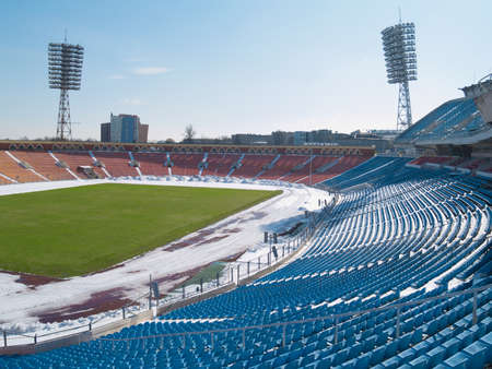Empty city stadium under snow