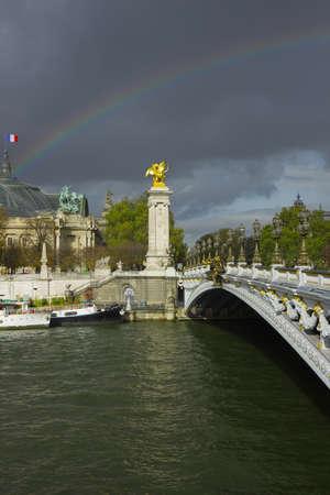 Alexander the Third bridge and Seine under rainbow in Paris
