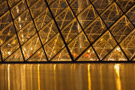 PARIS,FRANCE - NOVEMBER 06: Entrance to Louvre Museum on November 06, 2012 in Paris. The crystal pyramid was completed in 1989, it has become a landmark of of Paris. Stock Photo - 16337618