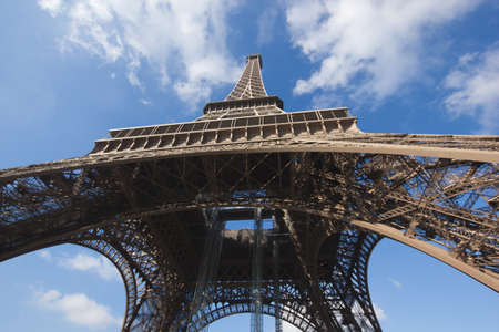 sunlit Eiffel Tower, Paris, against blue sky from below Stock Photo - 16393914