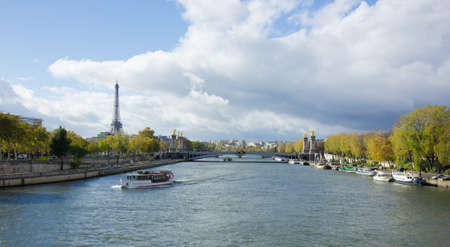 panoramic view of Eiffel Tower with Alexander the Third bridge, Paris, as seen from Seine