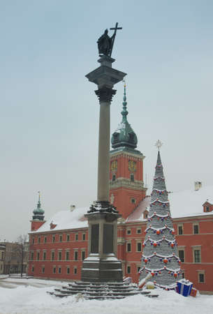 Warsaw Castle Square with king Sigismund column and christmas tree under snow at winter