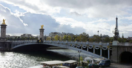 Alexander the Third bridge and Seine under stormy clouds in Paris, France