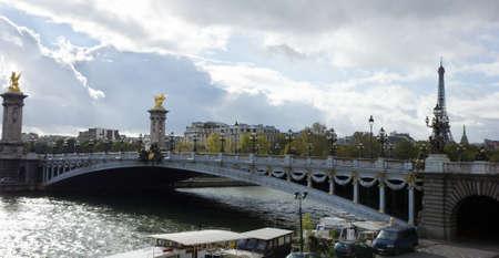 Alexander the Third bridge and Seine under stormy clouds in Paris, France