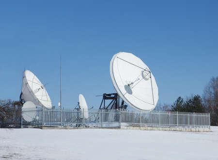 Satellite dish antenna station in snows