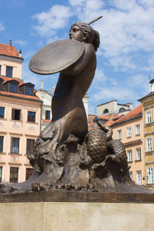Symbol of Warsaw - mermaid over old Town colorful houses, Poland Stock Photo