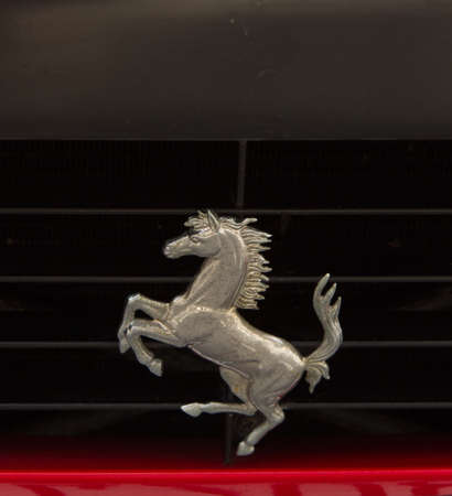 PUERTO DE LA CRUZ - JULY 14: The Cavallino Rampante, symbol of Ferrari on red luxury car at opening of Exposicion de vehiculos antiguos y clasicos, on July 14, 2013 in London. Ferrari has used the Cavallino Rampante since 1929.