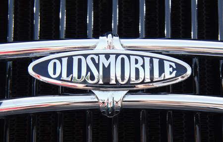 PUERTO DE LA CRUZ - JULY 14: Oldsmobile symbol on anique luxury car at town boulevard, on July 14, 2013 in Puerto de la Cruz. Oldsmobile founded in 1897 was the oldest american car marque.