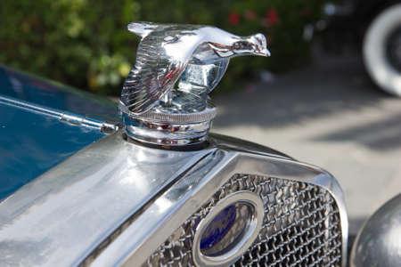PUERTO DE LA CRUZ - JULY 14: The emblem the car Ford, flying duck, on July 14, 2013 in Puerto de la Cruz. Ford is oldest American multinational automotive manufacturing company. Editorial