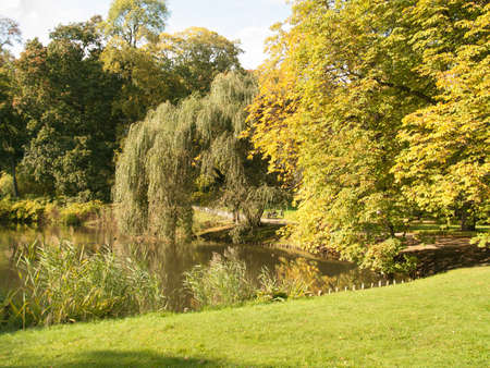 Autumn classic park over pond, Warsaw, Poland