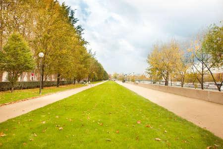 Autumn city alley in Paris near Seine river
