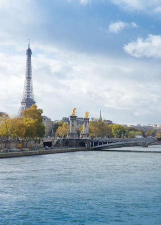 view of autumn Seine river with Eiffel Tower with Alexander the Third bridge, Paris, France Stock Photo
