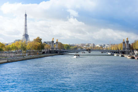 panoramic view of autumn Seine river with Eiffel Tower with Alexander the Third bridge, Paris