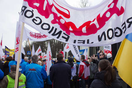 WARSAW - MARCH 8: Protesters rally near russian embassy against invasion to Crimea, Ukraine during an event organized by Solidarity trade union in Warsaw, Poland on March 8, 2014