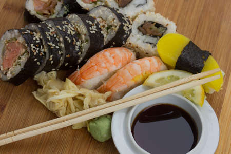 traditional japanese sushi and rolls set on wooden tray