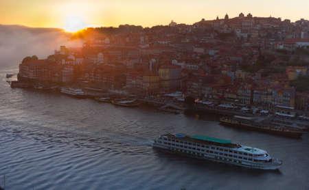 douro: Porto, Portugal cityscape at sunset over the Douro River.